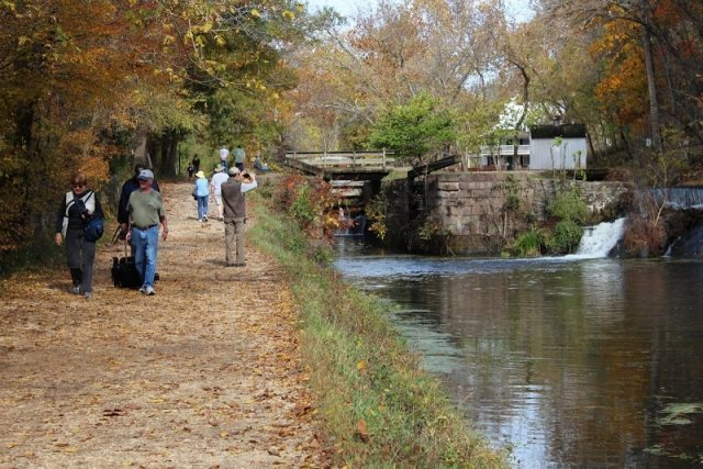 Visitors walking along the river on the Maryland side among the abundance of colorful leaves.