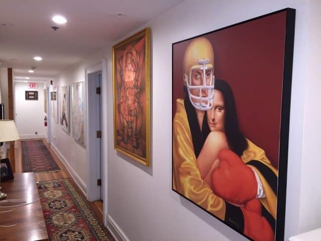 The hallways are decorated with many original paintings around the inn.