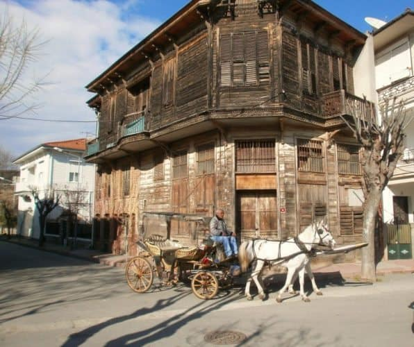 19th-century wooden mansion with feyton passing by on Buyukada