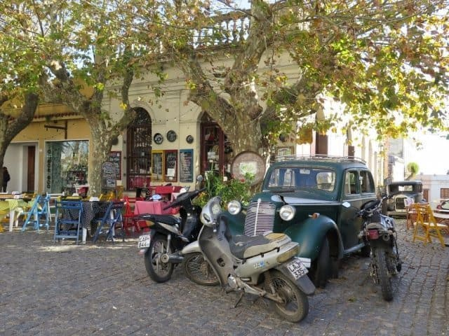 A cafe and old cars on Plaza de Armas Manual Lobo. Beth Reiber photos.