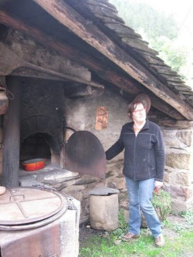 Monique Fraissinet shows us a wood-fired oven, still used today.
