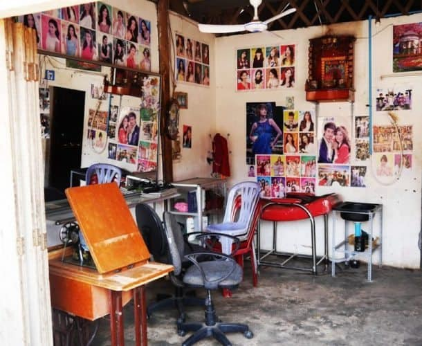 A local barber shop with celebrity hairstyles splashed throughout the walls.