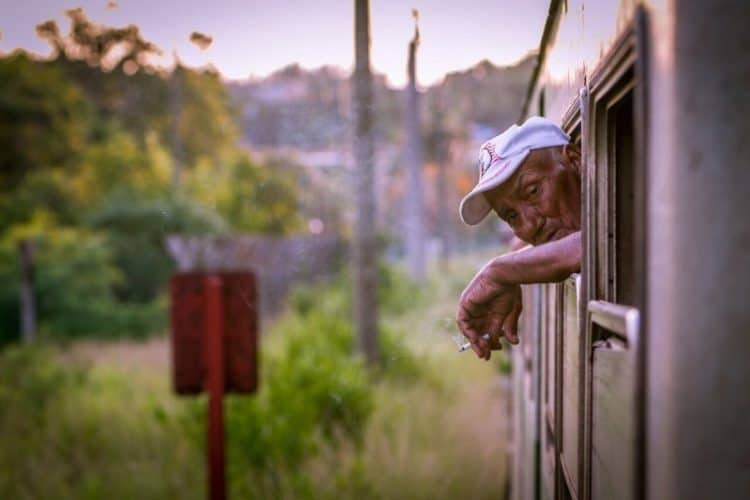 Engineer peers out the train's window.