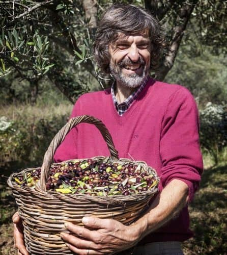 Nature guide Claudio Speroni with a basket of fresh picked olives.