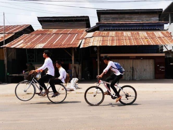 School kids ride home.