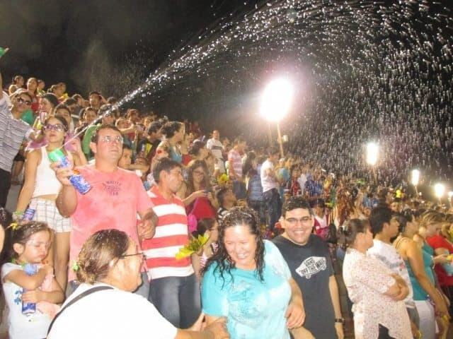 Watch out for snow spray in the crowds at the Carnival Encarnacion in Paraguay. Adam Lambert photos.