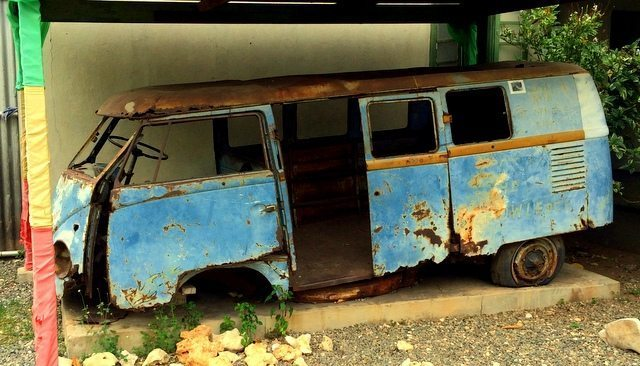 The rusting shell of Bob Marley's Volkswagen camper van in the courtyard of lower First Street in Trench Town, West Kingston, Jamaica.