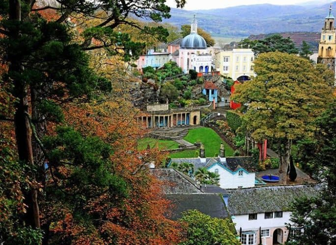 Portmeirion is an Italian-style tourist village in Gwynedd, North Wales designed and built by architect Sir Clough Williams-Ellis between 1925 and 1975. Many visitors recognize it as a filming location and setting for