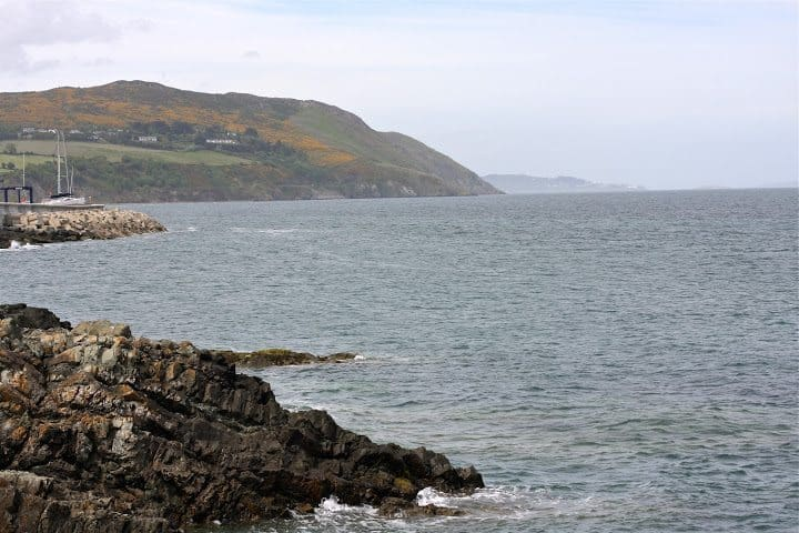 The cliff walk starts in Greystone and skirts the cliff on the horizon ending in Bray seven kilometers away.