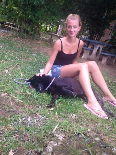 Lisa with a rescued dog in Thailand.