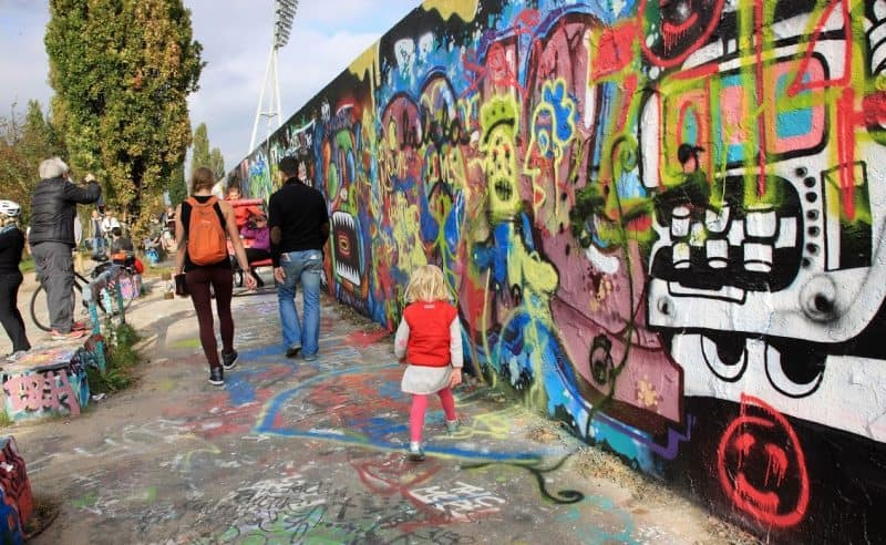 Color and youth fill the streets of Berlin where parts of the infamous historic Cold War Berlin Wall still stand.