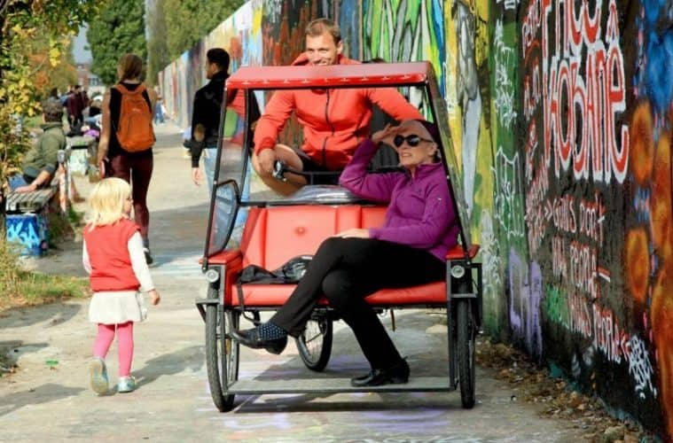 See Berlin from a bike, rickshaw, or even a bed.