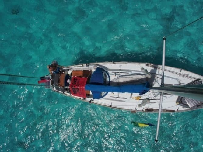 I climbed the mast to get a real view of the clear water and my boat.