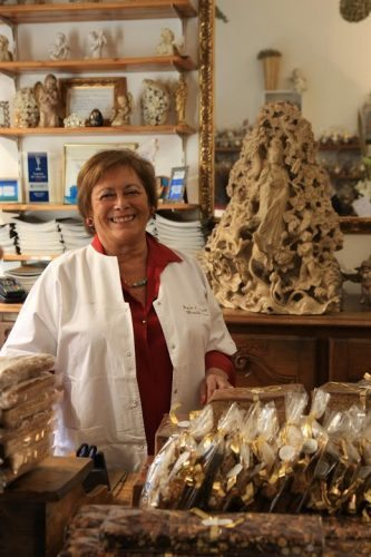 Mireille Oster, owner of a gingerbread shop in Strasbourg, greets guests with a warm smile in the Petite France historic quarter of the city of Strasbourg, France.