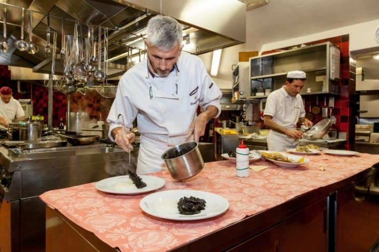 Chef/owner Marco Toffolin and Luca Sccarpel in the kitchen at Locanda da Lino