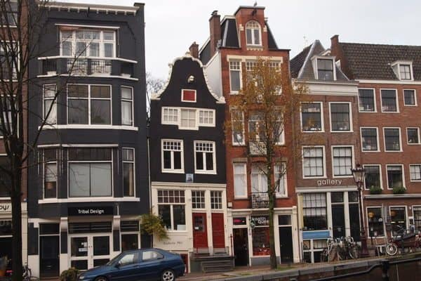 Houses on the Spiegelkwartier, an arts and antiques district in Amsterdam. drunken tourist
