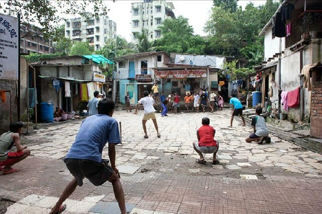 Playing cricket in the streets of Mumbai.