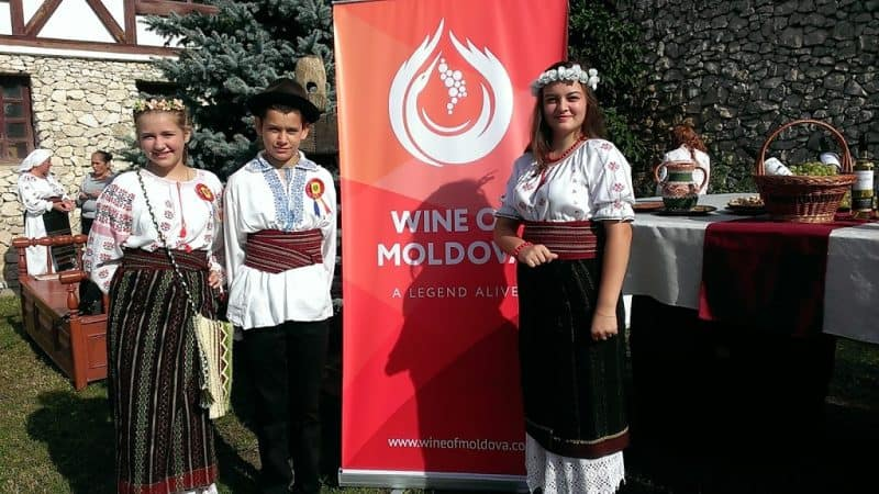 A Asconi local students in national dress for National Wine Day.