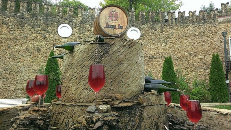 A Mliestii Mici entrance display barrel pouring into glasses.