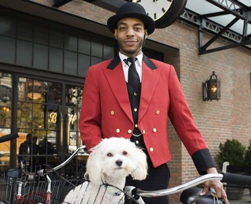 The friendly doorman at the Bowery Hotel, with a guest.