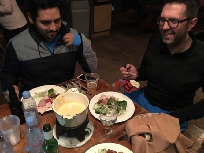 Enjoying traditional cheese fondue atop the mountain in the Relais des Trappeurs.