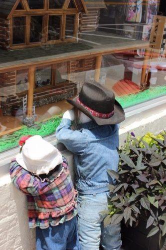 Kids in doll shop window in Bardstown, Kentucky.