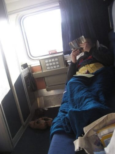 Napping in the train cabin.