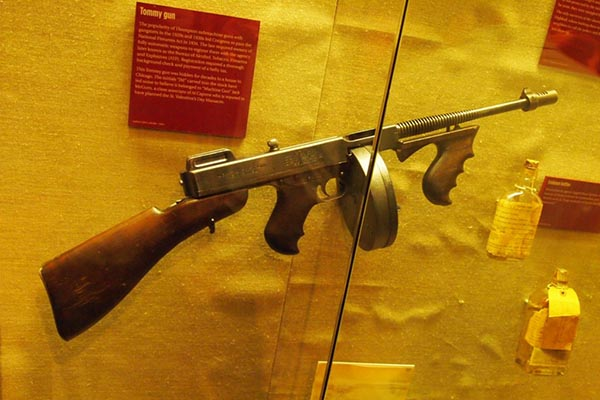 A Tommy gun like the ones used in the famous St Valentine's Day massacre in 1928, on display with the actual wall from Chicago, at the Mob Museum.