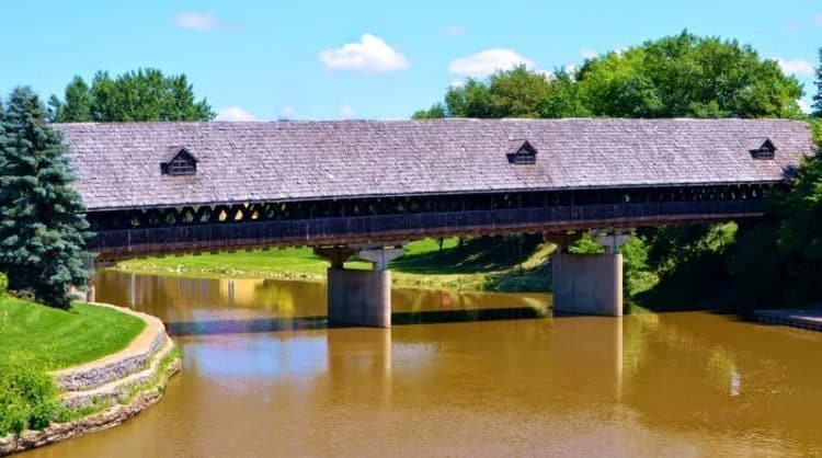 A View of Holzbrucke Wooden Covered Bridge from the River Place Shops