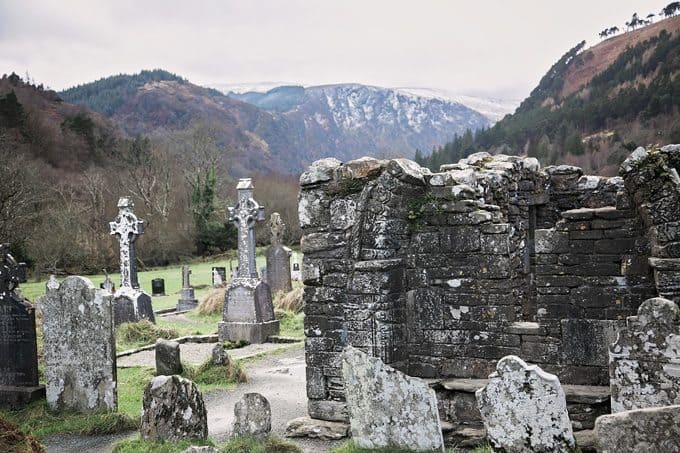 Through the gravestones of Glendalough, the snow covered Wicklow Mountains are vivid in the distance. Seeing Southern photos. Ireland in January