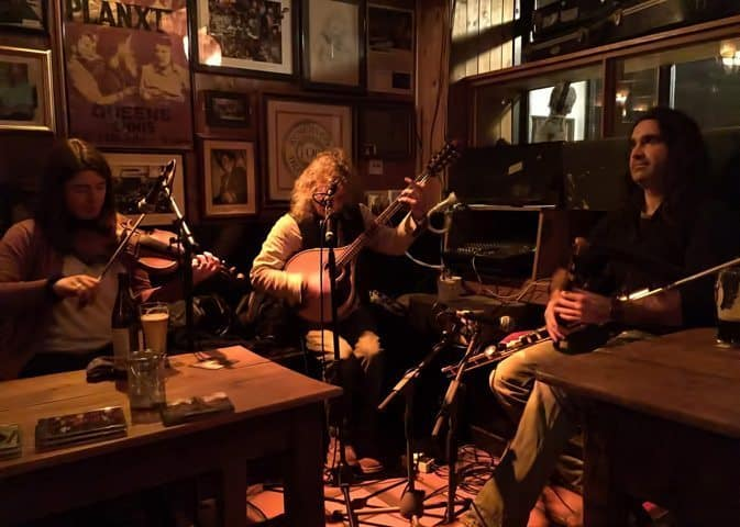 In Doolin at McGann's Pub, a few locals and many visitors gather to be emboldened by the Irish tunes of Cyril O'Donoghue (middle) and Blackie O'Connell (right).