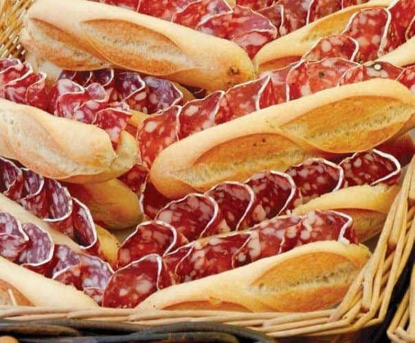 The delights of a Provencal market start with a fresh baguette.