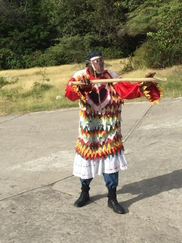 One of the many performers in costume ready to recite as best as he can.