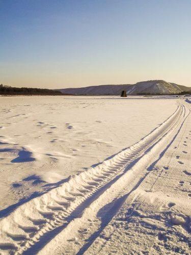 Frozen river road.