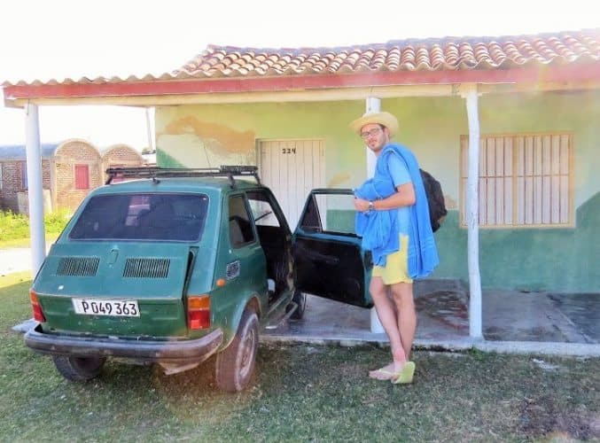 The author's husband posing with our ride to and from Playa Caletones.