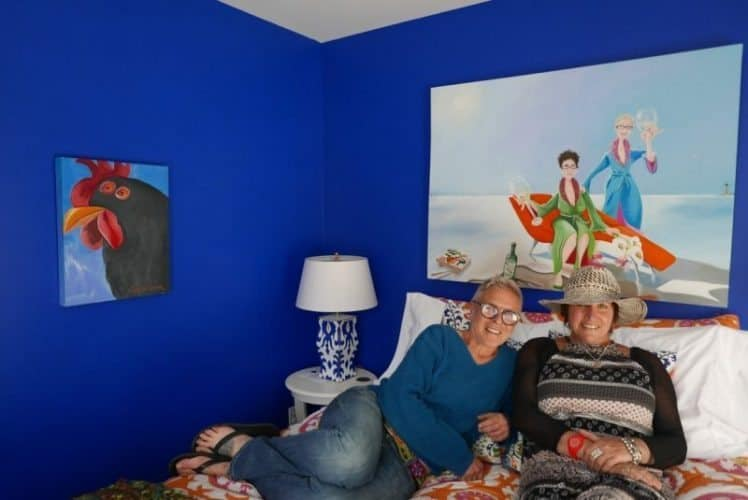 Roux B&B owners Alison and Ale relaxing in one of their bedrooms.
