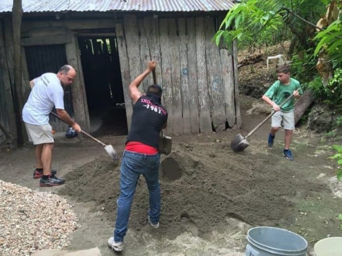 Mixing cement to build floors in Guatemala. GlobeAware sends volunteers to help local families.