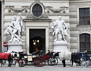 Horse-drawn carriages in front of the Hofburg Imperial Palace in Vienna, Austria