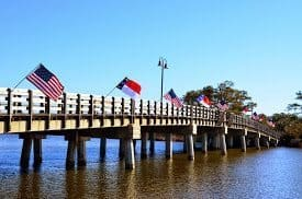 Flags of many nations on the wharf where the Starry Night is docked in North Carolina.
