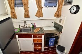 The compact galley, or kitchen in the boat allows you to prepare meals while staying on board.