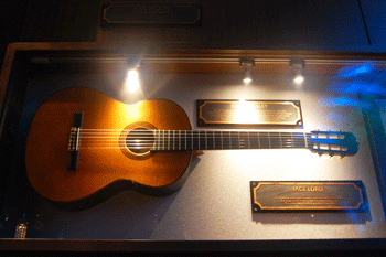 Jack Lord's guitar at the Hard Rock Cafe in Honolulu. Elvis used to play it, too.