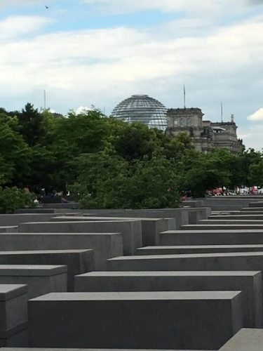 Visitors can schedule an appointment to walk around the dome in the background for fabulous views of Berlin.
