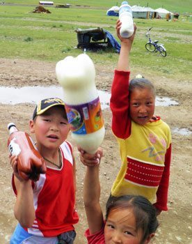 Kids selling fermented mare's milk in Mongolia