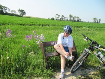 Rolling fields and a convenient bench make for a pleasant stop to remove stones from shoes or tires.