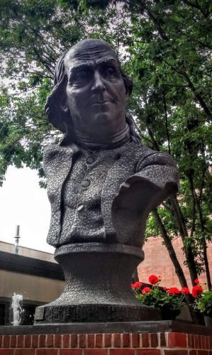 At Benjamin Franklin's grave, a bust made out of keys signifying one of his most important discoveries and innovations in electric conductivity.