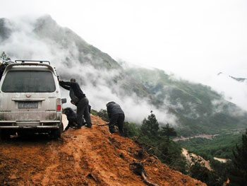 The first landslide of the day in Tagong, China.