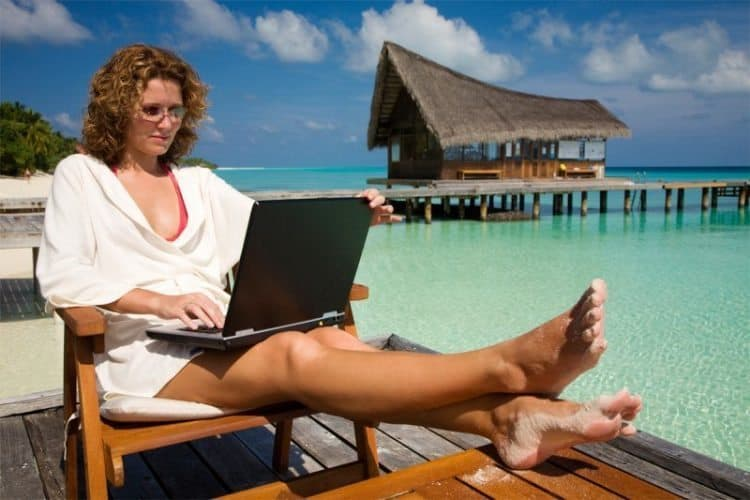 While many Americans take no vacation, others manage to work while they vacation, which sometimes can prove tiring.