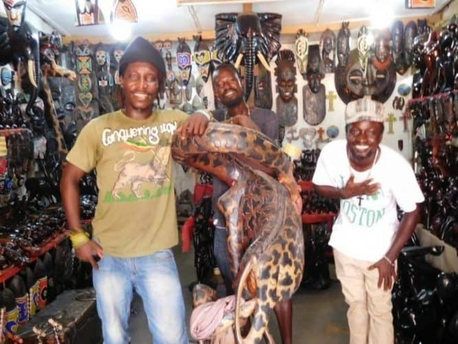 A shop selling carved wooden statues in a market in Accra.
