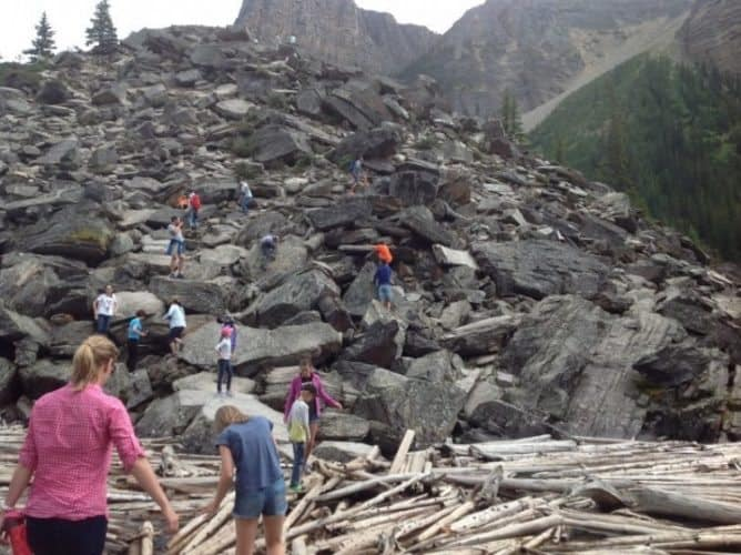 Climbing the rocks next to Moraine Lake in Alberta.
