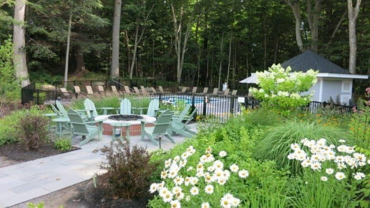 The pool and the firepit of the Inn at Diamond Cove, in Southern Maine.